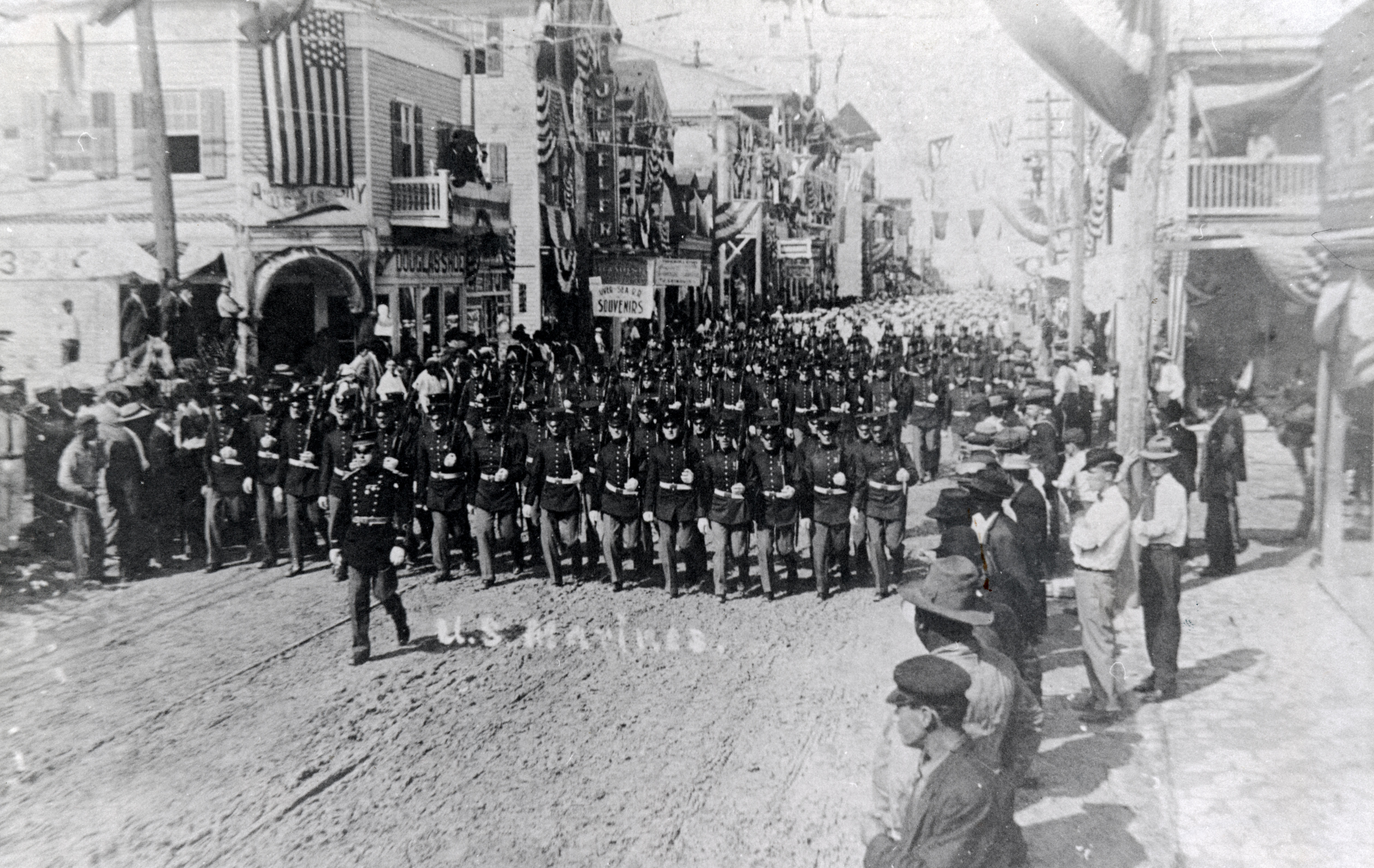 Marines marching on Duval Street in parade for Key West rail. Florida Keys Public Library. Retrieved from