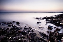mix (helen sotiriadis) Tags: longexposure pink blue sunset sea white seascape black water canon landscape rocks published smooth athens greece rough canonefs1022mmf3545usm ndfilter saronida canoneos40d updatecollection