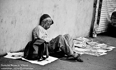 Sleeping newspaper vendor. (Reyne Villena) Tags: cebu cebusugbo teampilipinas nationalgeographictheworldaroundus fl♥ckrhearts nikond60clubphilippines photokalye pipho|pinoyphotographyorg