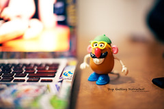 231/365 Mr. Potato Head. (Victor Mui) Tags: blue original red white blur color green classic feet glass smile hat childhood yellow canon project pose toy nose photography foot 50mm glasses photo kid shoes colorful day shot arms mr desk bokeh head laptop object picture objects next victor moustache potato doodle lazy cap classics grin 5d 365 today per bedromm f12 231 mui macbook f12l disfocus 231365 victormui