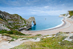 Footpath to Durdle Door (Simon Greig Photo) Tags: ocean uk morning sea england cliff cloud seascape beach water grass rock landscape coast europe arch view path steps scenic wideangle nobody unescoworldheritagesite dorset copyspace footpath durdledoor canonefs1022mmf3545usm jurassiccoast