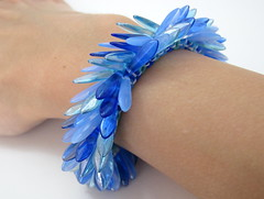 Peyote Cuff Bracelet - Fringed - Blue Peacock (randomcreative) Tags: blue skinny peacock jewelry bracelet fringed etsy beadwork feathered beadweaving buttonclasp beadwoven offloom daggerbeads randomcreative peyotecuff
