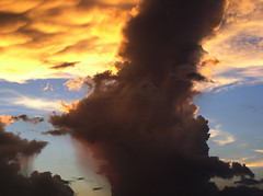 Evening Showers (Jason A. Samfield) Tags: sunset wild sky cloud sun sunlight nature beautiful rain weather silhouette backlight clouds spectacular outdoors shower evening amazing skies natural sunsets bluesky cumulus backlit sunsetting backlighting cumulonimbus rainshower cumulusclouds cumuluscloud justclouds cloudsilhouette orangerain