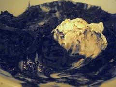 Black risotto with baccalà mantecato and silver foil