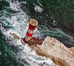The Needles Lighthouse - Isle of Wight (neilalderney123) Tags: sea lighthouse sepia airplane waves aeroplane isleofwight needles navigation trislander