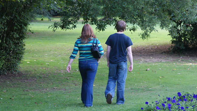 Mother and Son walking through grass and tree's