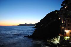 Where I met the Ocean. (AustinGohn) Tags: ocean blue sunset orange color night buildings landscape lights long exposure waves terre cinque nikond3000 austingohn