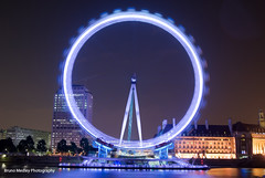 London eye at night (Bruno Medley) Tags: city uk longexposure travel light england urban motion reflection london tourism water westminster wheel millenniumwheel thames architecture night speed river fun outdoors dawn movement europe european time britain geometry capital central citylife culture engineering londoneye capsule landmark ferris structure illuminated southbank backgrounds metropolis british portal airways velocity topview attraction blurredmotion urbanscene sightsee cityofwestminster famousplace outdours lighttraces imponent