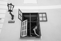 I could use some help... (Riga) (PaulHoo) Tags: riga people candid streetcandid lines girl woman frame framing fujifilm fuji x70 window clean cleaning streetphotography citylife lantern lamp 2017 bw blackandwhite monochrome