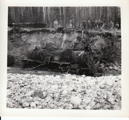 A railway locomotive tipped over intentionally to protect the tracks from erosion, near Skagway Alaska, circa 1948.