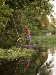 indnr7000136.jpg (keithlevit) Tags: trees india man tree men water boats photography boat asia fineart pole waters poles levit keithlevit keithlevitphotography