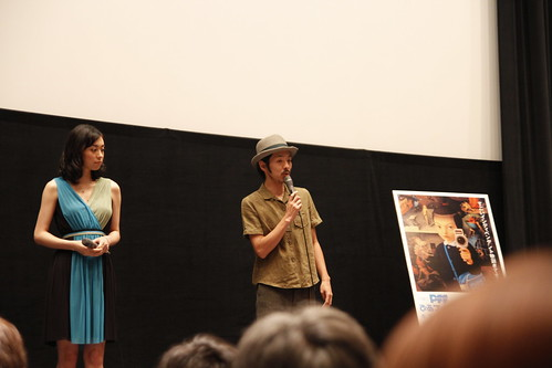Kankuro Kudo talking while Kazue Fukiishi listens during Gegege no Nyobo world premiere
