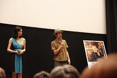 Kankuro Kudo talking while Kazue Fukiishi listens during Gegege no Nyobo world premiere
