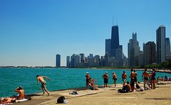 the Fake Beach (moke076) Tags: blue summer vacation people lake chicago water skyline standing buildings illinois jump random cement dive sunny run lakemichigan leap tanning sunbathing