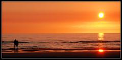 ZANDVOORT (Dagmar Panik) Tags: sunset shadow red sea summer people orange sun holland reflection rot beach water netherlands yellow strand abend sand nikon couple meer wasser sonnenuntergang sommer spiegel urlaub paar calming tourist explore gelb northsea sonne nordsee reflexion schatten zandvoort reflektion romantik prchen abendrot touristen ruhig romantisch sommerurlaub explored d80 18135mm nikond80 nikon18135mm sunsetmania sunsetsandsunrisesgold greatshotss