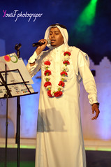 (Yousif Aljohar) Tags: red portrait white flower eye 50mm interesting nikon explore saudi fav nikkor 18 2010 yousif photograper  d90 aljohar explored