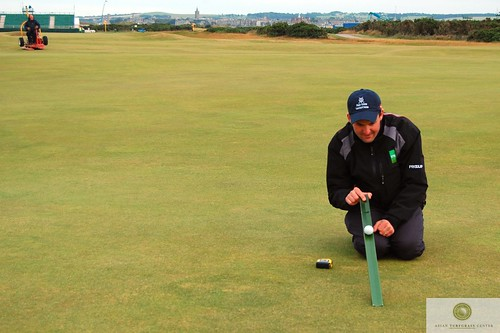 using a stimpmeter at the Open Championship