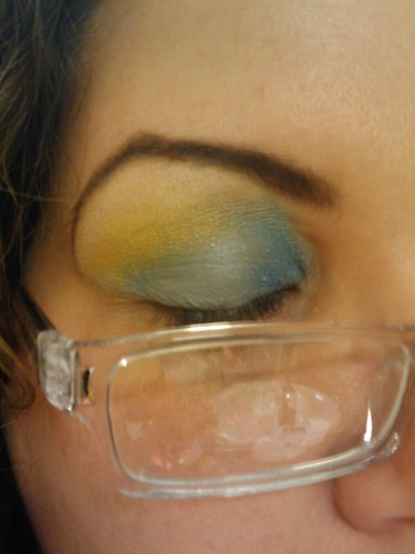 The same blue and yellow eyeshadow as above, with a closed eyelid so the color placement can better be seen.