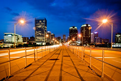 Richmond Skyline (Ty Johnson Photography) Tags: street city bridge light urban cars lines skyline night buildings manchester photography lights virginia nikon downtown action vivid rail symmetry richmond sidewalk lighttrails rva converging d3000
