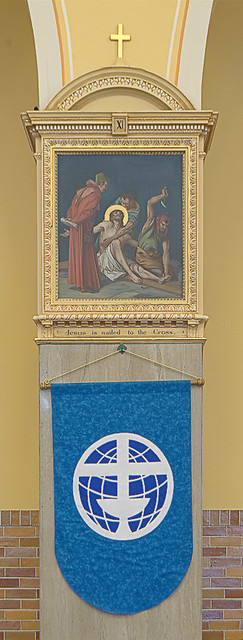 Saint Anthony Roman Catholic Church, in Lemay, Missouri, USA - station of the cross and banner