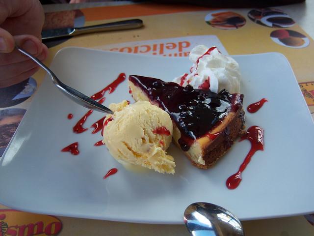Cheesecake, blueberry jam and cream.