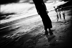 The lady from the water (Christer Johansen) Tags: leica sea blackandwhite bw beach water children spain sand sandra explore frontpage sansebastian wetfeet bwdreams dlux4