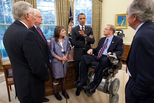 President Barack Obama talks with, from left, Rep. Steny Hoyer, D-Md., James Sensenbrenner, R-Wisc., Cheryl Sensenbrenner, James Langevin, D-R.I., and Sen. Tom Harkin, D-Iowa, in the Oval Office, July 26, 2010, prior to an event on the South Lawn commemorating the 20th anniversary of the Americans with Disabilities Act. (Official White House Photo by Pete Souza)