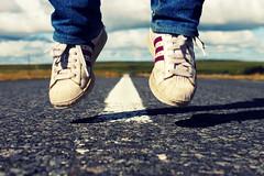 A dream, a way, a road... (Ai in Technicolor) Tags: road verde feet montagne freedom iceland jump shoes strada shadows ombra ground salto adidas terra superstar bianco piedi linea scarpe libertà faraway islanda sovraesposizione