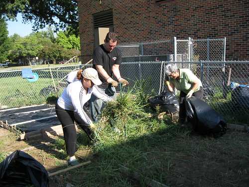 SWR FNS employees (left to right) Patricia Mancha, Edward Mekeel and Lupe Gomez clear out gardening plots in B.H. Macon Elementary School's People's Garden.