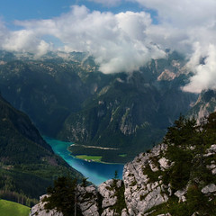 The breathtaking alpine mountains of the Knigssee (Bn) Tags: lake germany bavaria berchtesgaden topf50 day cloudy topf300 kings fjord hikers paragliding thealps bluelake topf200 paragliders verticalpanorama knigssee stbartholom 50faves 200faves nationalparkberchtesgaden jennerbahn 300faves berchtesgadennationalpark germanbavarianalps southofgermany saariysqualitypictures schnauamknigssee berchtesgadenalps cleanestlakeingermany stretchesabout77km formedbyglaciers nearborderwithaustria jennermountaintop1870m picturesquesetting sheerrockwalls playaflugelhorn steeplyrisingflanksofmountainsupto2700m hikingtrailsupthesurroundingmountains royalmountainexperience thebreathtakingalpinemountainsoftheknigssee