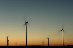 wind power plants during sunset (wunderskatz) Tags: blue sunset sky sun plant windmill night energy long exposure hungary power wind clean friendly environment rotation safe protection eco renewable windgenerator bony windengine
