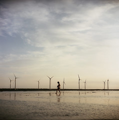 A girl on the wind ( ken ) Tags: sky 120 6x6 film windmill girl kodak taiwan greatwall     portra160nc   taizhong gaomei
