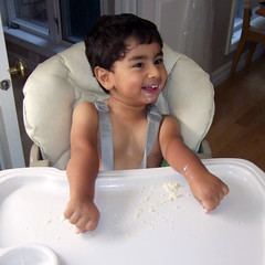 Oliver playing with rice pudding