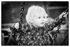 Gracie. (stblackburn) Tags: child girl swing bw portrait outdoor playing park