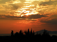 Every Sunset Is Unique (Tassos Giannouris) Tags: kos greece sun sunset clouds sky sea trees zoom set horizon
