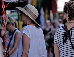 Woman with straw hat (pigianca) Tags: italy siena woman portrait streetphoto urbanphoto fujixt1 fujinon90mmf2