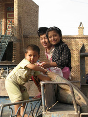 Friendly Uyghur children at market