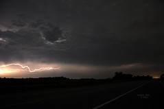 Lightning and Road (baresilver) Tags: summer sky storm weather night clouds outside bright overcast kansas lightning plains distance hwy7 hwy69 hwy166