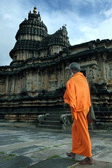Sringeri (vbsuresh) Tags: old orange india man art stone architecture bag walking temple design colours structure talent 7d karnataka hindu visitor pilgrimage carvings pilgrim sadhu skill sharada sringeri shankaracharya shimoga templetown kaavi