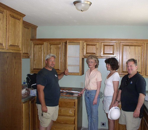 Jeromy Smith, Smith Woodworking, shows off his beautiful kitchen cabinetry to USDA Marietta Area Director Carol Costanzo, Barbara Conover, CEO of Three Rivers, and Tony Logan, Rural Development State Director.