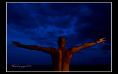 Shouting a curse at the sky (pharriergraph) Tags: sky man tattoo bald tattoos shore tungsten shoulders cto strobist