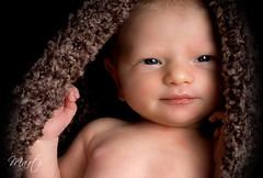 Peek-a-boo Antoinette (FLPhotonut) Tags: portrait baby smile infant newborn antoinette cocoon homestudio canon50d flphotonut interfit150exmkii