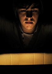 Surprise (stephendun) Tags: light boy shadow portrait man lamp smile self canon person key box low stephen surprise duncanson 1000d stephendun