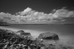 Penmaenmawr (Pensans) Tags: ocean longexposure sea mist beach water wales clouds canon eos rocks waves pebbles 30d nd10 penmaenmmawr