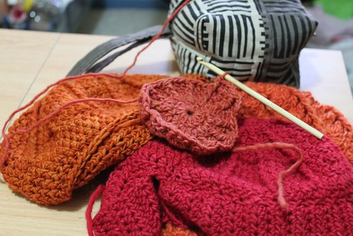 Crocheting the last of the hats