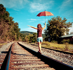 happy trails (sparkleplenty_fotos) Tags: red umbrella traintracks getty plaid gettyimages hcs happyclichesaturday licensedbygetty