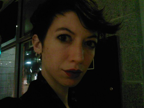 Blurry night phonesnap with lipstick.