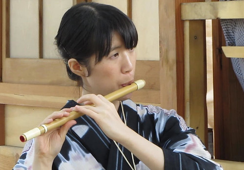 Female flutist at Omikoshi ceremony, Powell Street Festival 2010 where Japanese tradition meets new expression in Vancouver Canada