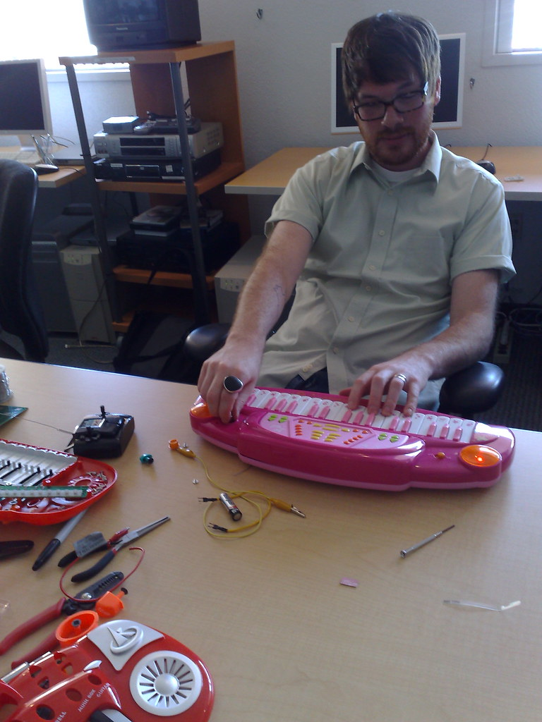Jentery Sayers plays modified keyboard toy at USC IML Circuit Bending Workshop by Garnet Hertz