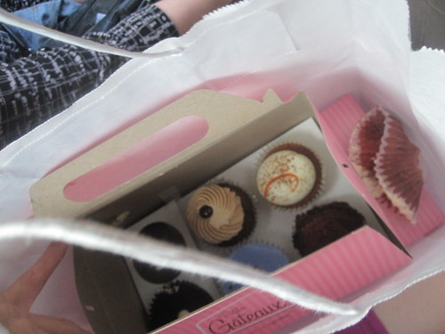 Eating a cupcake in the cab, on the way to the restaurant (cupcakes brought by France)